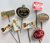 8 vintage Dutch pin badges advertising Bros Bensdorp Selba B&R confectionery D