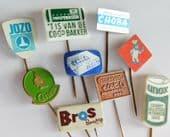 9 vintage Dutch pin badges food advertising Unox Choba Castella Co-op Koopmans Q