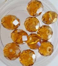 Faceted beads 8mm x 6mm. Gold x 10