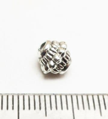 Tibetan Style Silver dotted bicone beads x 14. 7mm.