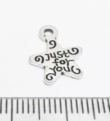 Tibetan Style Silver 'Just for you' star charms. x 12.